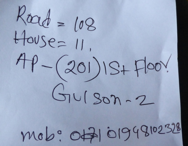 Handwritten address... with phone number.
