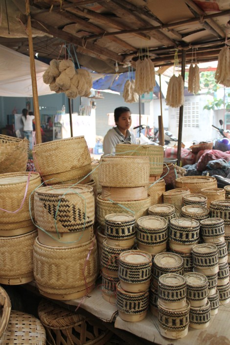 Various sizes of rice serving baskets for sale at Phousi Market in Luang Prabang, Laos.