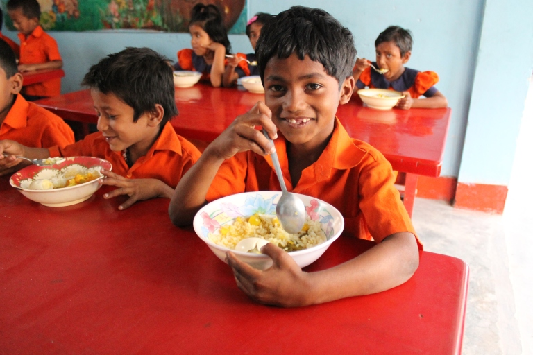 One egg a day. The kids can eat more rice and vegetables but protein is expensive.
