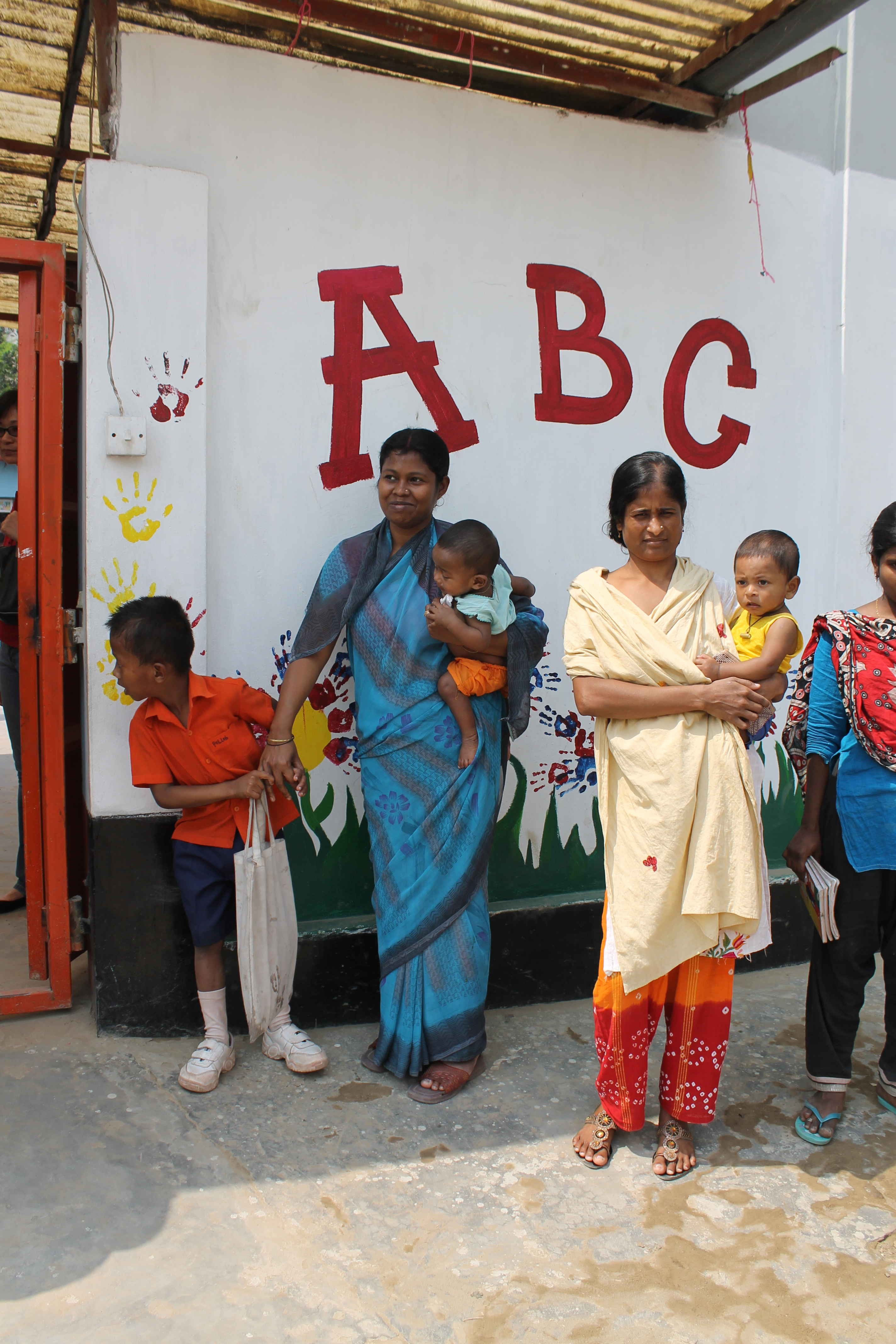 Parents picking up kids at the ABC school.