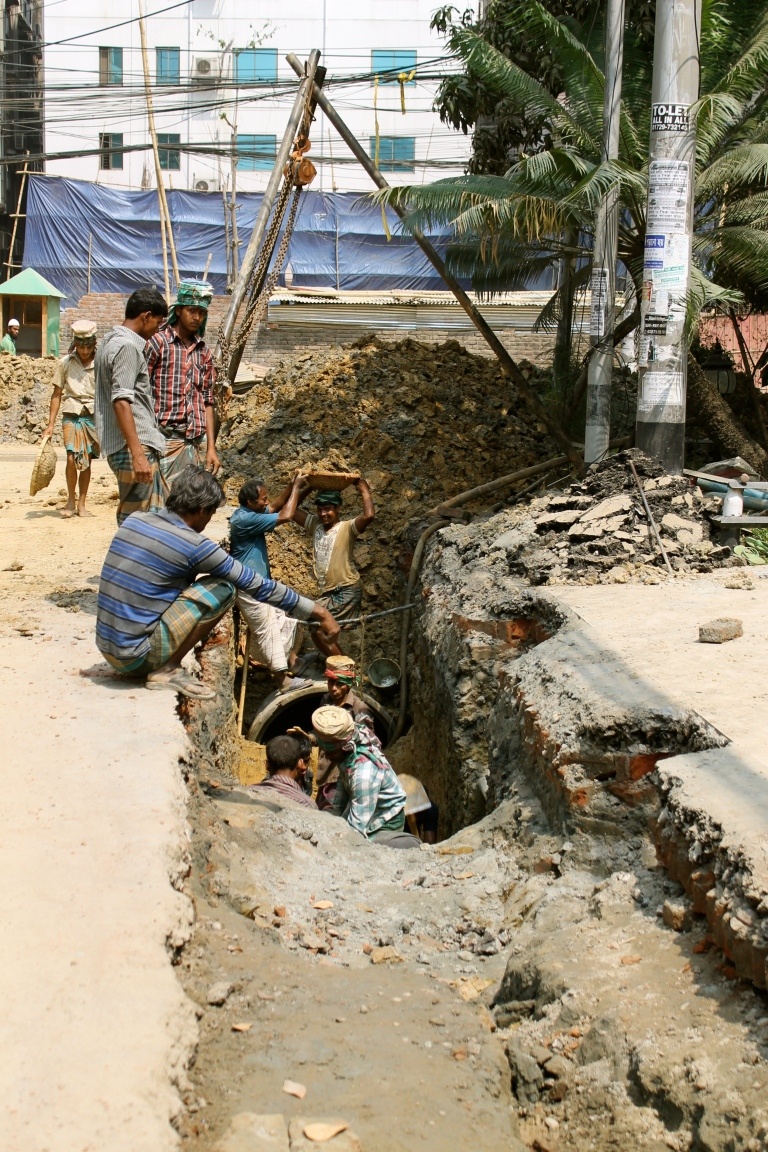Digging in the streets of Dhaka.