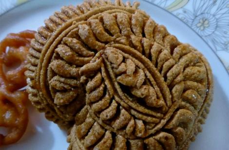Phul Pitha, a Bangladeshi flower shaped cookie.