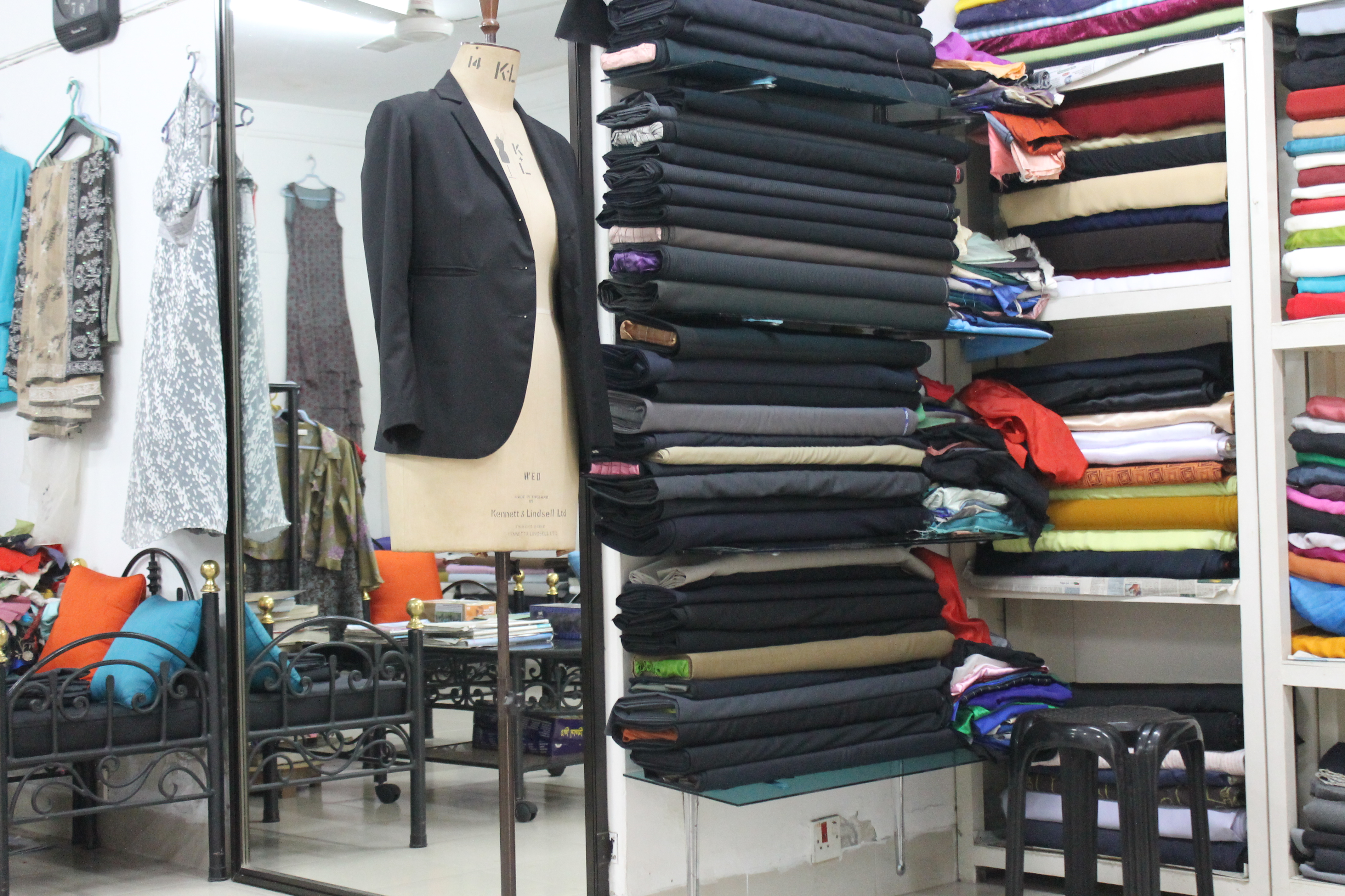 Most tailors sell cloth as well.
