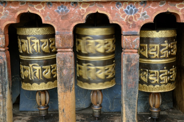 Prayer wheels spinning in this Buddhist country.