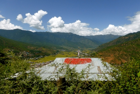 The Paro valley and red chiles drying on a rooftop.