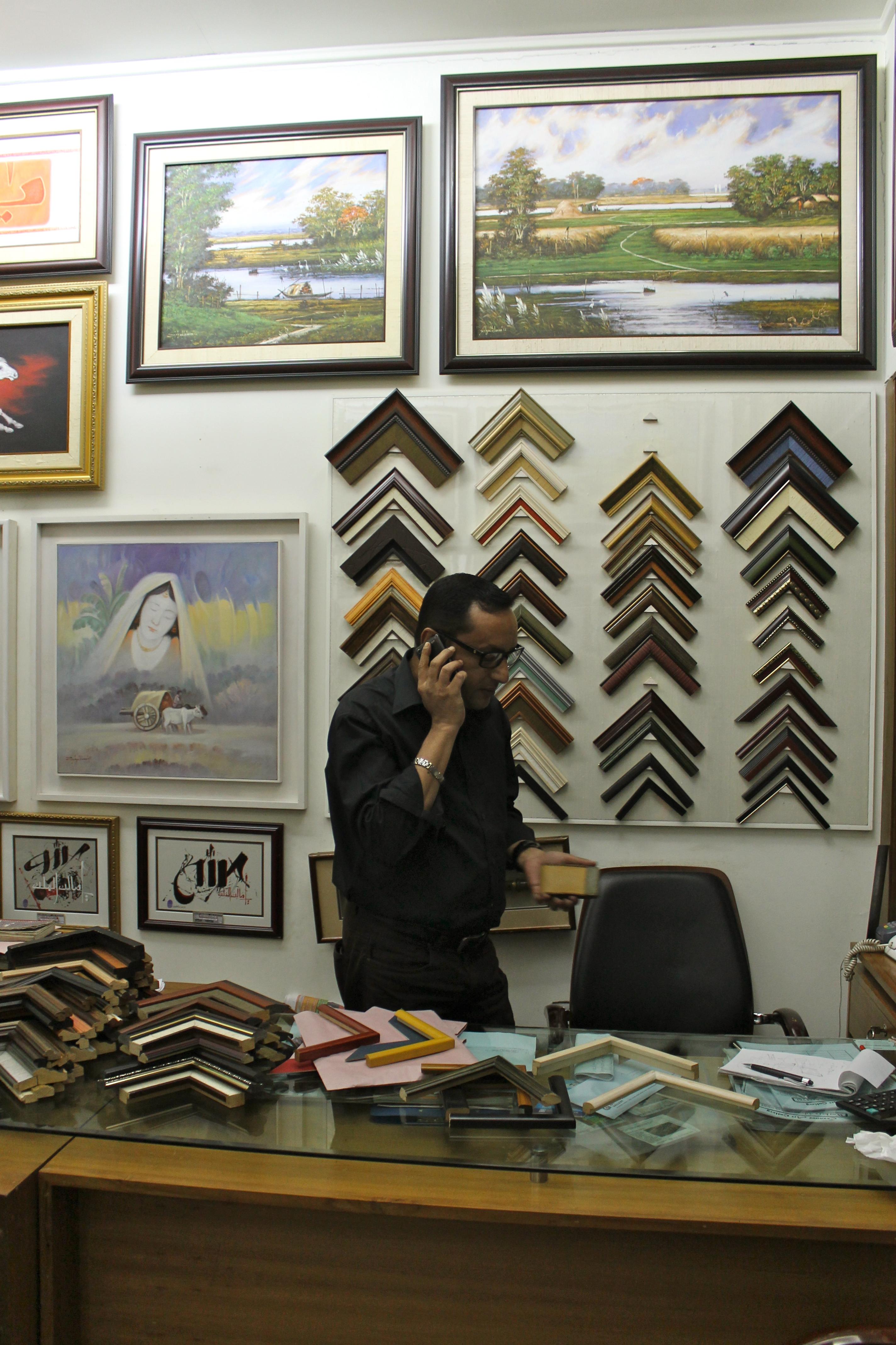 Shamim in his frame shop.