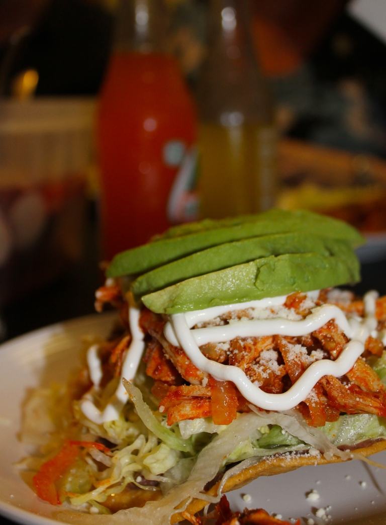 The most photogenic dish - a tostada with chicken.
