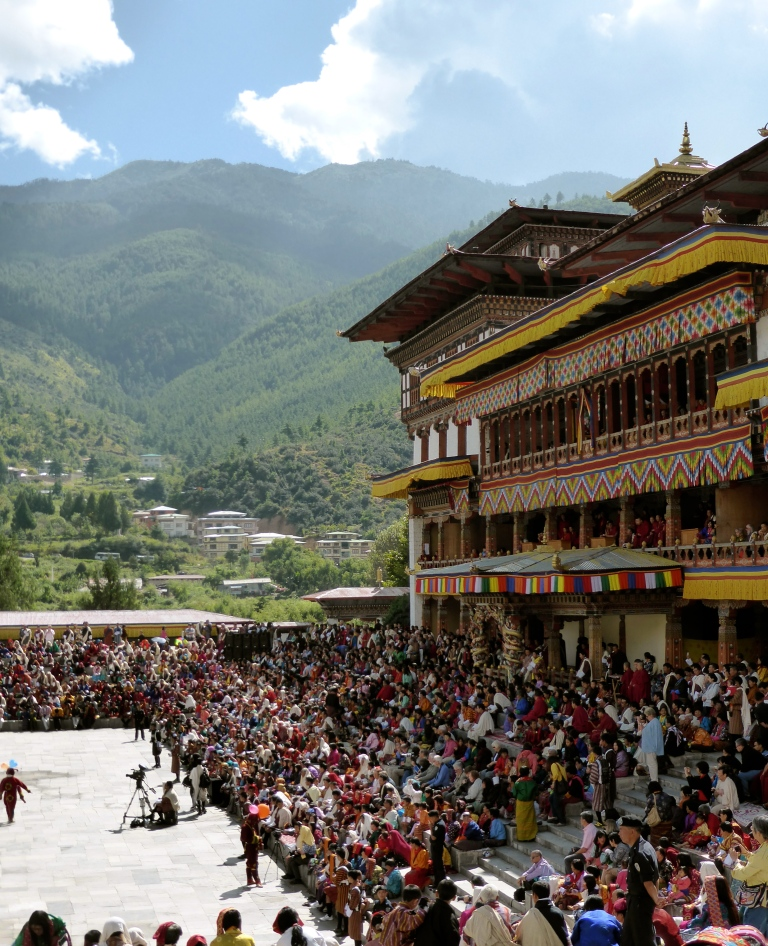 "The plaza outside the ""dzong"" in Thimphu with tsechu crowds."