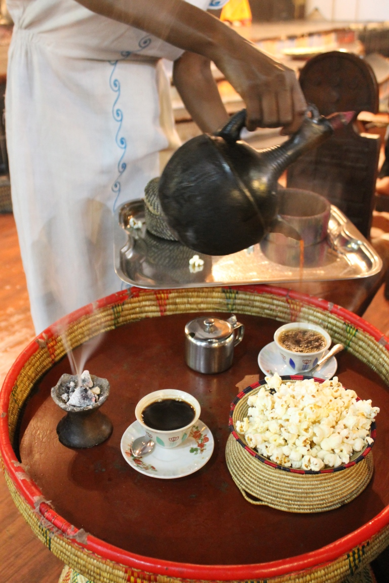 Coffee served with air freshener and popcorn.