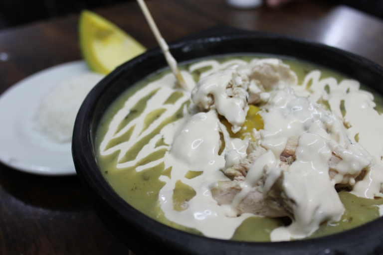 Ajiaco, soup with chicken breast, guasco, rice, corn, and avocado.