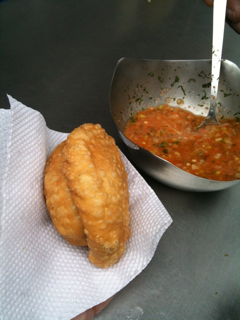 Freshly deep fried empanada and salsa.
