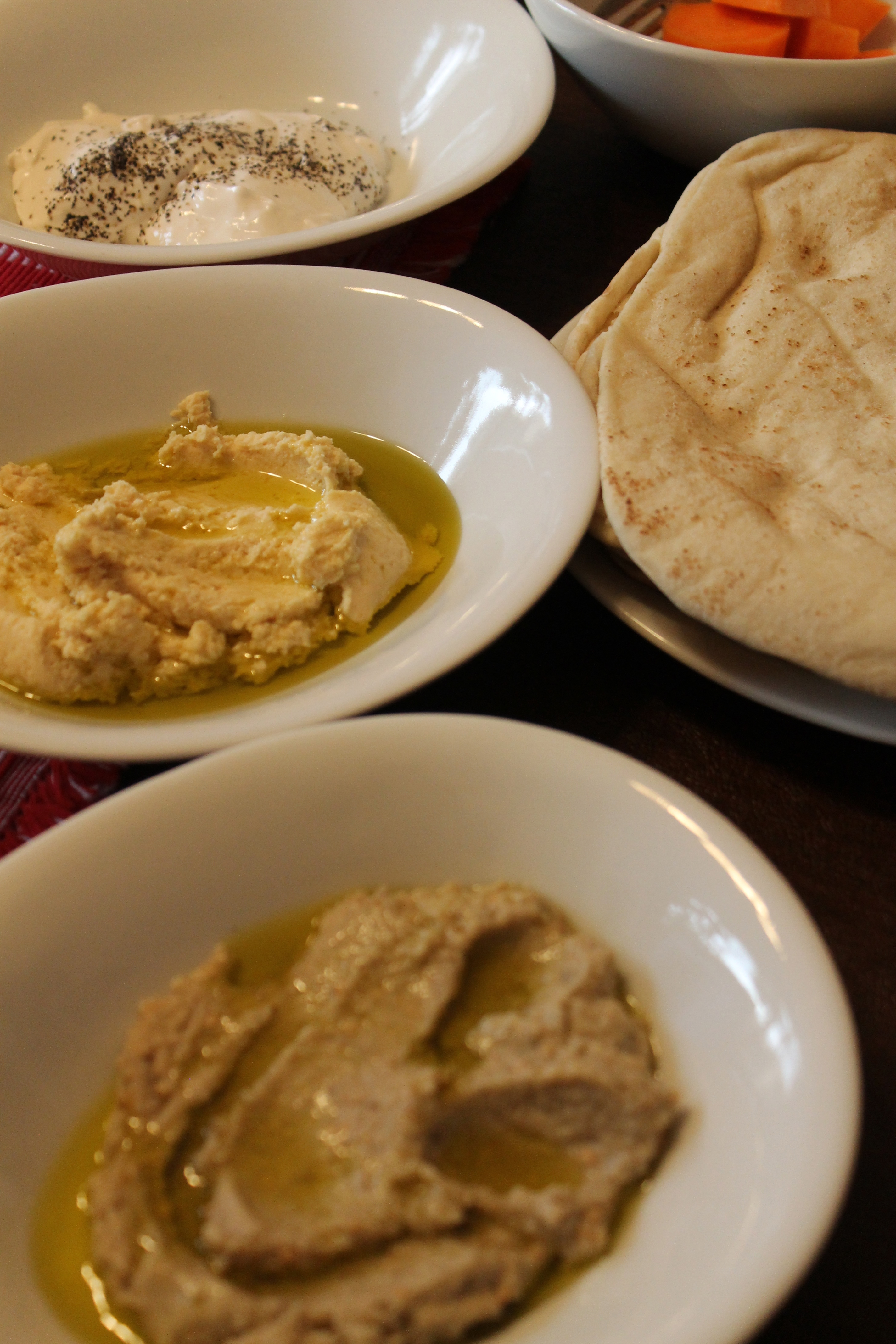 Hummus, babaganoush, labnah, and pita bread.