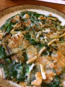 Japanese-Korean seafood pancake with long green onion-chive vegetables.