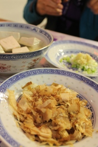 Fresh tofu, ginger and onion, and bonito (dried fish) flakes.