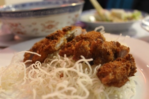 Fried cutlet on rice noodles.