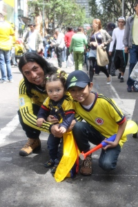 A father and his kids in Bogota.
