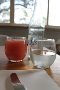 Fresh pomelo juice in a curvacious glass.